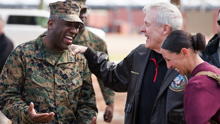 Secretary of the Navy Ray Mabus, center, speaks with Sgt. Maj. of the Marine Corps Ronald Green, left, and 1st Lt. Terri L. Piekosz, a series commander with November Company, 4th Recruit Training Battalion, March 3, 2016 at Marine Corps Recruit Depot Parris Island, S.C. Mabus visited Parris Island to see firsthand how young men and women from across the country are transformed into United States Marines. Recruit training was consolidated under Recruit Training Regiment in 1986, and since then, all those desiring to complete recruit training must follow the same training program of instruction, and must complete the same graduation requirements.