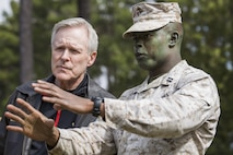 Secretary of the Navy Ray Mabus, left, speaks with Capt. Larry Black Jr., commander of Delta Company, 1st Recruit Training Battalion, about training March 3, 2016, on Parris Island, S.C. Mabus visited Marine Corps Recruit Depot Parris Island in order to see firsthand how young men and women from across the country are transformed into United States Marines. Recruit training was consolidated under Recruit Training Regiment in 1986, and since then, all those desiring to complete recruit training must follow the same training program of instruction, and must complete the same graduation requirements. (Photo by Staff Sgt. Greg Thomas)