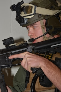 """Standing watch over """"hostage negotiations"""" during an active shooter exercise in Lejeune Hall."""