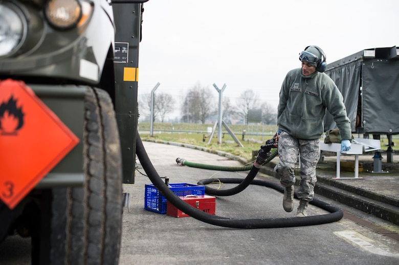 Senior Airman Julian Ortiz-Serrano, a 424th Air Base Squadron fuels management technician, stows a hose after refilling a fuel truck at Chièvres Air Base, Belgium, Feb. 25, 2016. Romero is one of 70 Airmen assigned to the 424th ABS. (U.S. Air Force photo/Staff Sgt. Sara Keller)