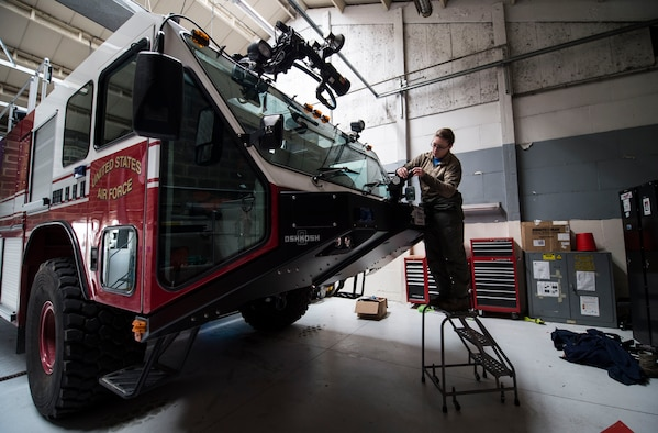 Senior Airman Nicole Franklin, a 424th Air Base Squadron special vehicle mechanic, inspects the no-foam system on a Striker 1500 firetruck at Chièvres Air Base, Belgium, Feb. 26, 2016. Airmen with the 424th ABS provide airfield operations support for the Supreme Allied Commander Europe and Supreme Headquarters Allied Powers Europe, NATO transient aircraft and distinguished visitors. (U.S. Air Force photo/Staff Sgt. Sara Keller)