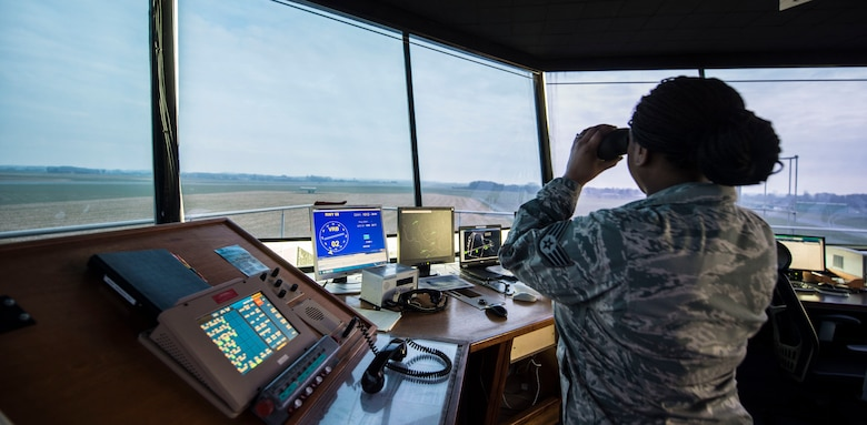 Staff Sgt. Nicole Walker, a 424th Air Base Squadron air traffic controller, peers out the Chievres Air Base tower in Belgium, Feb. 26, 2016. The 424th ABS operates the airfield and runways at Chievres AB while providing support to the Supreme Allied Commander Europe and Supreme Headquarters Allied Powers Europe, NATO transient aircraft and distinguished visitors. (U.S. Air Force photo/Staff Sgt. Sara Keller)