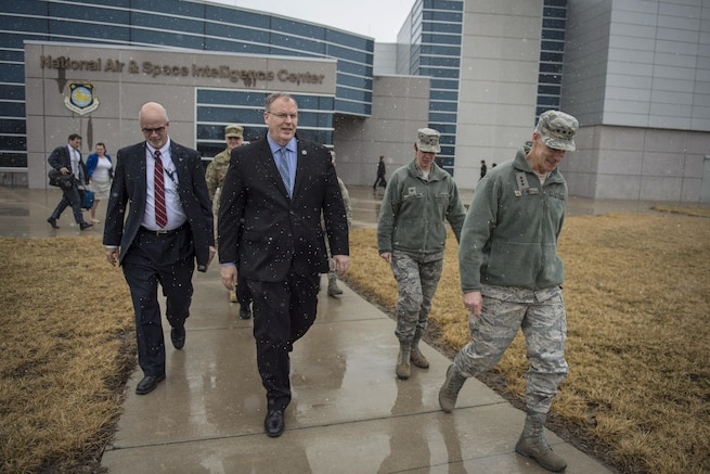 """Deputy Secretary of Defense Bob Work and Air Force Lt. Gen. Robert """"Bob"""" Otto, right, deputy chief of staff for intelligence, surveillance and reconnaissance at Air Force headquarters in Washington, D.C., talk after visiting the National Air and Space Intelligence Center on Wright-Patterson Air Force Base, Ohio, March 3, 2016, DoD photo by Air Force Senior Master Sgt. Adrian Cadiz"""