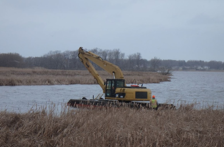 The arrival of a pontoon excavator to the Braddock Bay Ecosystem Restoration Project will allow the project to continue on-schedule despite unseasonably wet conditions.
