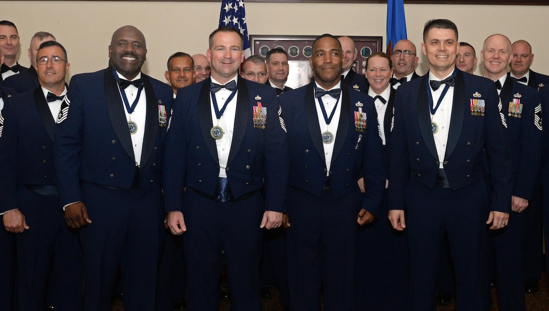 (Left to right) Senior Master Sgt. Joseph L. Wheeler, Senior Master Sgt. Michael S. Kuhn, Chief Master Sgt. Mark P. Jackson, and Chief Master Sgt. Bobby J. Chittom, Beale's newest and select chief master sergeants, pose for a photo during a chief recognition ceremony March 3, 2016, at Beale Air Force Base, California. More than 100 members of Team Beale attended to celebrate the Airmen who accomplished to be among the top one percent of the U.S. Air Force's enlisted force structure. (U.S. Air Force photo by Senior Airman Ramon A. Adelan)