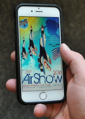 The 2016 Defenders of Freedom Open House and Air Show poster is projected full-screen on a smart phone March 3, 2016 on Offutt Air Force Base, Neb. The air show planners are scheduled to roll-out a brand new application in June which will feature maps, directions, parking and much more.