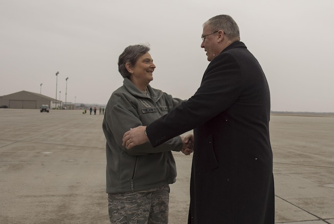 Deputy Defense Secretary Bob Work is greeted by Air Force Gen. Ellen M. Pawlikowski, commander, Air Force Materiel Command, as he arrives at Wright-Patterson Air Force Base, Ohio, for a visit and a tour of the base March 3, 2016. DoD photo by Air Force Senior Master Sgt. Adrian Cadiz