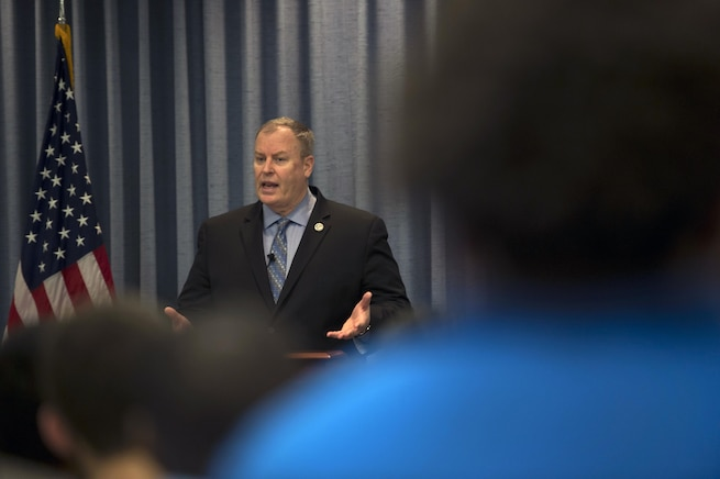 """Deputy Defense Secretary Bob Work speaks to a group of students from the local Dayton, Ohio, area during 'Week at the Labs"""" event at Wright-Patterson Air Force Base, Ohio, March 3, 2016. DoD photo by Air Force Senior Master Sgt. Adrian Cadiz"""