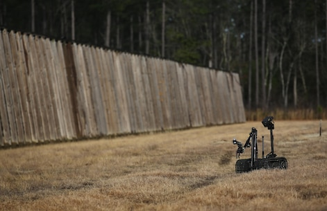 A TALON robot, operated by Marines with Explosive Ordnance Disposal  Platoon, Combat Logistics Battalion 2, scouts an area for improved explosive devices during a field exercise at Camp Lejeune, N.C., March 2, 2016. Marines used equipment such as compact metal detectors, bomb suits and a TALON robot to locate and handle ordnance, which took the form of a simulated IED, ammunition or artillery shell. (U.S. Marine Corps photo by Cpl. Paul S. Martinez/Released)