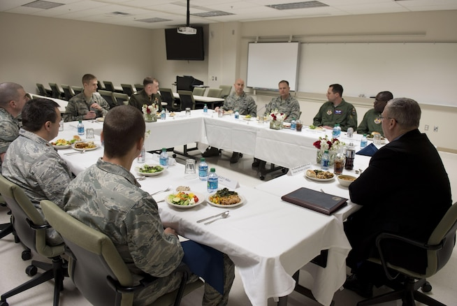 Deputy Defense Secretary Bob Work has lunch with military members enrolled in The Air Force Institute of Technology during a visit to Wright-Patterson Air Force Base, Ohio, March 3, 2016. AFIT is a graduate school and provider of professional and continuing education for the United States Armed Forces. DoD photo by Air Force Senior Master Sgt. Adrian Cadiz
