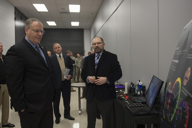 """Deputy Defense Secretary Bob Work is briefed on some of the emerging military technology during a visit to Wright-Patterson Air Force Base, Ohio, where he toured the base and spoke to students from the local Dayton, Ohio, area during the 'Week at the Labs"""" event March 3, 2016. DoD photo by Air Force Senior Master Sgt. Adrian Cadiz"""