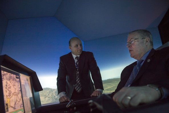 Deputy Defense Secretary Bob Work operates a flight simulator during his visit to Wright-Patterson Air Force Base, Ohio, in support of the White House's Week at the Labs initiative, March 3, 2016. Work also toured the base and spoke to students from the Dayton, Ohio, area during his visit. (DOD photo/Air Force Senior Master Sgt. Adrian Cadiz)