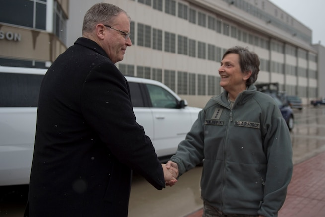 """Deputy Defense Secretary Bob Work, left, says goodbye to Air Force Gen. Ellen M. Pawlikowski, commander, Air Force Materiel Command, as he departs Wright-Patterson Air Force Base, after touring the base and speaking to a group of students from the local Dayton, Ohio, area during 'Week at the Labs"""" event March 3, 2016. DoD photo by Air Force Senior Master Sgt. Adrian Cadiz"""