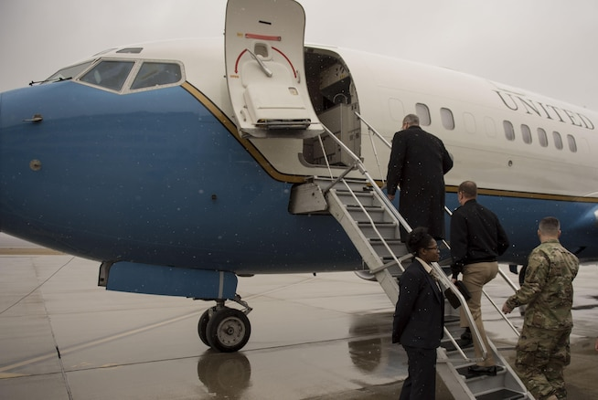 """Deputy Defense Secretary Bob Work boards an aircraft as he departs Wright-Patterson Air Force Base, Ohio, after touring the base and speaking to a group of students from the local Dayton, Ohio, area during 'Week at the Labs"""" event March 3, 2016. DoD photo by Air Force Senior Master Sgt. Adrian Cadiz"""