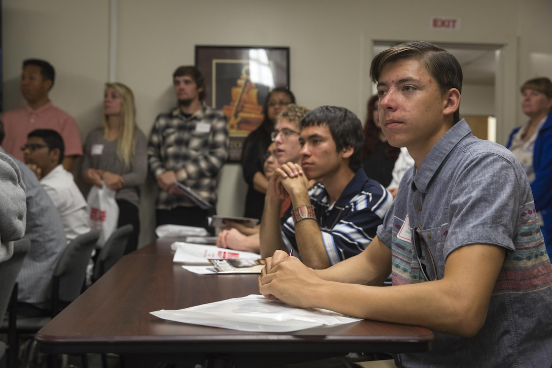 Twentynine Palms High School Students wait to meet their sponsors during the 13th annual Job Shadowing Event aboard the Combat Center Feb. 23, 2016. The event began as a partnership between the Morongo Unified School District and the installation and provides students with insight on potential careers. (Official Marine Corps photo by Lance Cpl. Levi Schultz/Released)