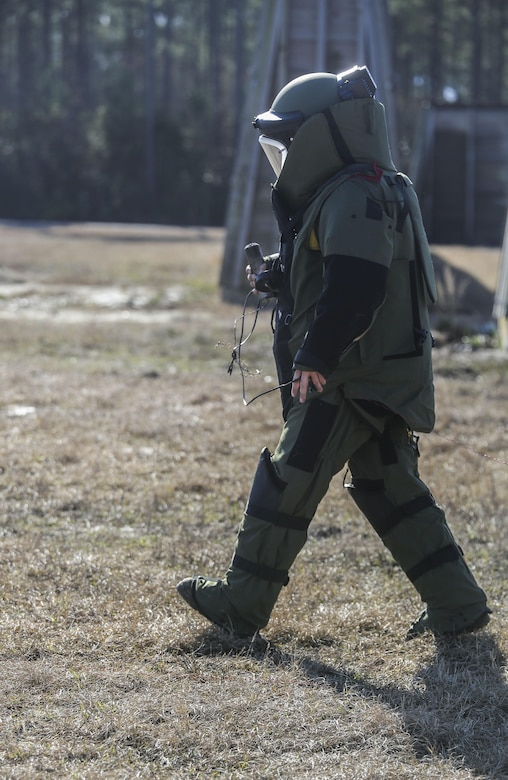 A Marine with  Explosive Ordnance Disposal  Platoon, Combat Logistics Battalion 2, prepares ordnance for detonation during a field exercise at Camp Lejeune, N.C., March 2, 2016. The training served as the last field operation prior to the battalion's upcoming deployment with the Special Purpose Marine-Air Ground Task Force-Crisis Response-Africa. (U.S. Marine Corps photo by Cpl. Paul S. Martinez/Released)