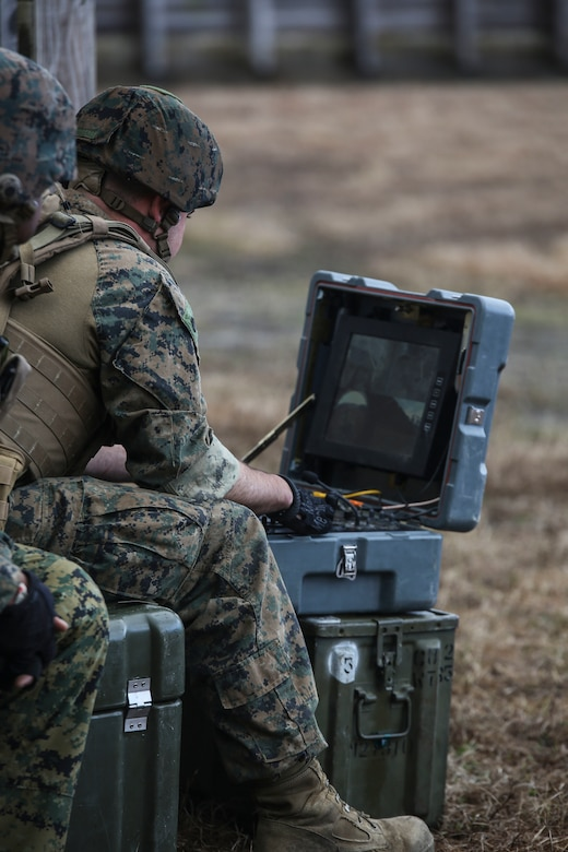 A Marine with  Explosive Ordnance Disposal  Platoon, Combat Logistics Battalion 2, operates the command console for a TALON robot to sweep for improvised explosive devices during a field exercise at Camp Lejeune, N.C., March 2, 2016. The training served as the last field operation prior to the battalion's upcoming deployment with the Special Purpose Marine-Air Ground Task Force Crisis Response-Africa. (U.S. Marine Corps photo by Cpl. Paul S. Martinez/Released)