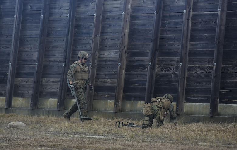Marines with Explosive Ordnance Disposal  Platoon, Combat Logistics Battalion 2, utilize a compact metal detector to sweep for improvised explosive devices during a field exercise at Camp Lejeune, N.C., March 2, 2016. Marines utilized equipment such as compact metal detectors, bomb suits and a  TALON robot to locate and handle ordnance, which took the form of a simulated IED, ammunition or artillery shell. (U.S. Marine Corps photo by Cpl. Paul S. Martinez/Released)