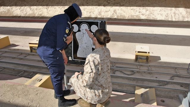 U.S. Marine Cpl. Leslie Souza, assigned to the 26th Marine Expeditionary Unit, reviews a target during live-fire training with the Kuwait Ministry of the Interior VIP Protection Unit, Female Division during an exchange with the 26th MEU's Female Engagement Team Jan. 31 to Feb. 11, 2016, in Kuwait City, Kuwait. The 26th MEU is embarked on the Kearsarge Amphibious Ready Group and is deployed to maintain regional security in the U.S. 5th Fleet area of operations.