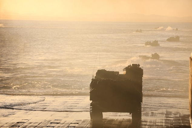 An Assault Amphibious Vehicle prepares to launch from the USS Essex (LHD 2) to the shore of Camp Pendleton Feb. 24, 2016. The launch marked the start of Company A, 3rd Assault Amphibian Battalion's, Marine Corps Combat Readiness Evaluation, which tested the unit's preparation for its upcoming deployment to Okinawa, Japan. (U.S. Marine Corps photo by Lance Cpl. Timothy Valero/ Released)