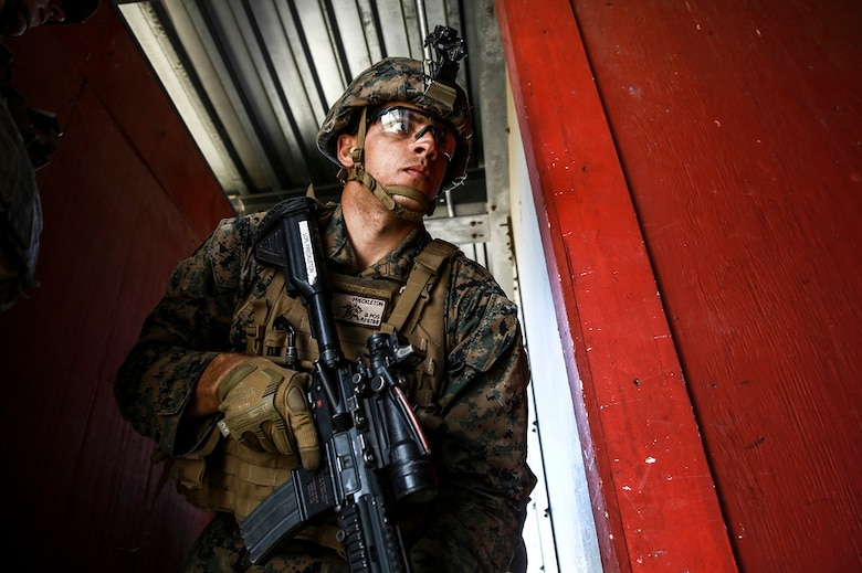 Lance Cpl. Roger Freckleton gets into position as the point man for his fire team during combat marksmanship training at Camp Pendleton March 2, 2016. The training was part of the Urban Leaders Course taught by 1st Marine Division Schools. The course focuses on enhancing small unit leadership through integrated training and implementation of fire teams and squad-sized elements in an urban setting. Freckleton is a scout rifleman with 1st Light Armored Reconnaissance Battalion, 1st Mar. Div., and a St. Augustine, Florida, native.  (U.S.  Marine Corps photo by Sgt. Emmanuel Ramos/Released)
