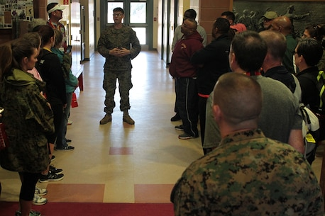 Educators receive a brief from Sgt. Kenneth R. Clinton, a Marksmanship Coach, before they enter the the indoor simulated marksmanship trainer (ISMT) March 2, 2016, aboard Marine Corps Recruit Depot Parris Island, S.C. The ISMT's purpose is to prepare the users with service rifles for live fire on a range. The educators are from the greater Atlanta, Ga., and Columbia, S.C., areas. (Official Marine Corps photo by Cpl. Diamond N. Peden/Released)