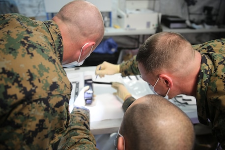 Marines with 2nd Law Enforcement Battalion conduct biometric exploitation during Tactical Site Exploitation training at Camp Lejeune, N.C., March 3, 2016. The unit built their own laboratory on the field to examine fingerprints and other critical pieces of evidence to recognize and assess possible enemy identities. (U.S. Marine Corps photo by Lance Cpl. Samuel Guerra/Released)