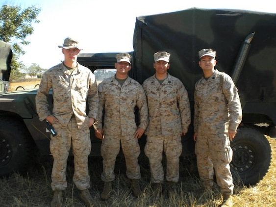 HM1(FMF) Argenis Mendoza (second from right), leading petty officer with Surgical Company B, 4th Medical Battalion, 4th Marine Logistics Group, Marine Forces Reserve, poses for a picture with Marines and Sailors from 4th MLG in Mozambique, Africa, during Operation Shared Accord in June 2010. Mendoza, a surgical technologist, is the Reserve component recipient of the 2015 Marine Forces Reserve Sailor of the Year award. [Courtesy photo by HM1(FMF) Argenis Mendoza]