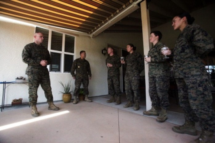 Sergeant Maj. Troy E. Black, the 1st Marine Logistics Group sergeant major, talks about leadership with meritoriously promoted sergeants during a lunch aboard Camp Pendleton, Calif., Feb. 23, 2016. Four meritoriously promoted sergeants shared an afternoon with Brigadier Gen. David A. Ottignon, the 1st MLG commanding general, the MLG sergeant major, and Master Chief Petty Officer Harlan B. Patawaran, the 1st MLG command master chief. The gathering served as an ideal opportunity to draw on the leaders' knowledge and experience through discussions of leadership, work ethic, family life, and what it means to be a sergeant of Marines. The four Marines promoted included Sgt. Casey Primeaux, a combat engineer with 7th Engineer Support Battalion, Sgt. Nadia Gonzalezdiez, a food service specialist with Food Service Company, Headquarters Regiment, Sgt. Ryan Langham, a communications maintenance technician with Combat Logistics Battalion 5, and Sgt. Tyrose Lawas, a warehouse clerk with Combat Logistics Regiment 15, all under 1st MLG