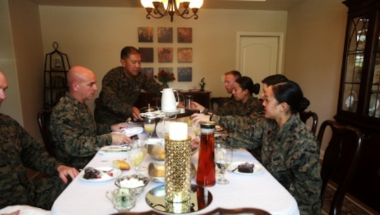 Brigadier Gen. David A. Ottignon, the 1st Marine Logistics Group commanding general, Master Chief Petty Officer Harlan B. Patawaran, the command master chief of 1st MLG, and Sgt. Maj. Troy E. Black, the sergeant major of 1st MLG, share lunch with meritoriously promoted sergeants aboard Camp Pendleton, Calif., Feb. 23, 2016. The gathering served as an ideal opportunity for the four meritoriously promoted sergeants to draw on the leaders' knowledge and experience through discussions of leadership, work ethic, family life, and what it means to be a sergeant of Marines. The four Marines promoted included Sgt. Casey Primeaux, a combat engineer with 7th Engineer Support Battalion, Sgt. Nadia Gonzalezdiez, a food service specialist with Food Service Company, Headquarters Regiment, Sgt. Ryan Langham, a communications maintenance technician with Combat Logistics Battalion 5, and Sgt. Tyrose Lawas, a warehouse clerk with Combat Logistics Regiment 15, all under 1st MLG.