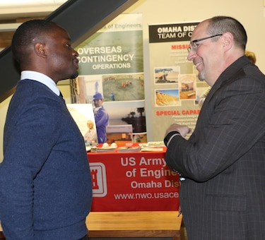 Gabriel Nsengiyumva, National Society of Black Engineering student, shares his love for civil engineering with John Bertino, Chief Engineering Division during an Engineering Week event at the University of Nebraska.
