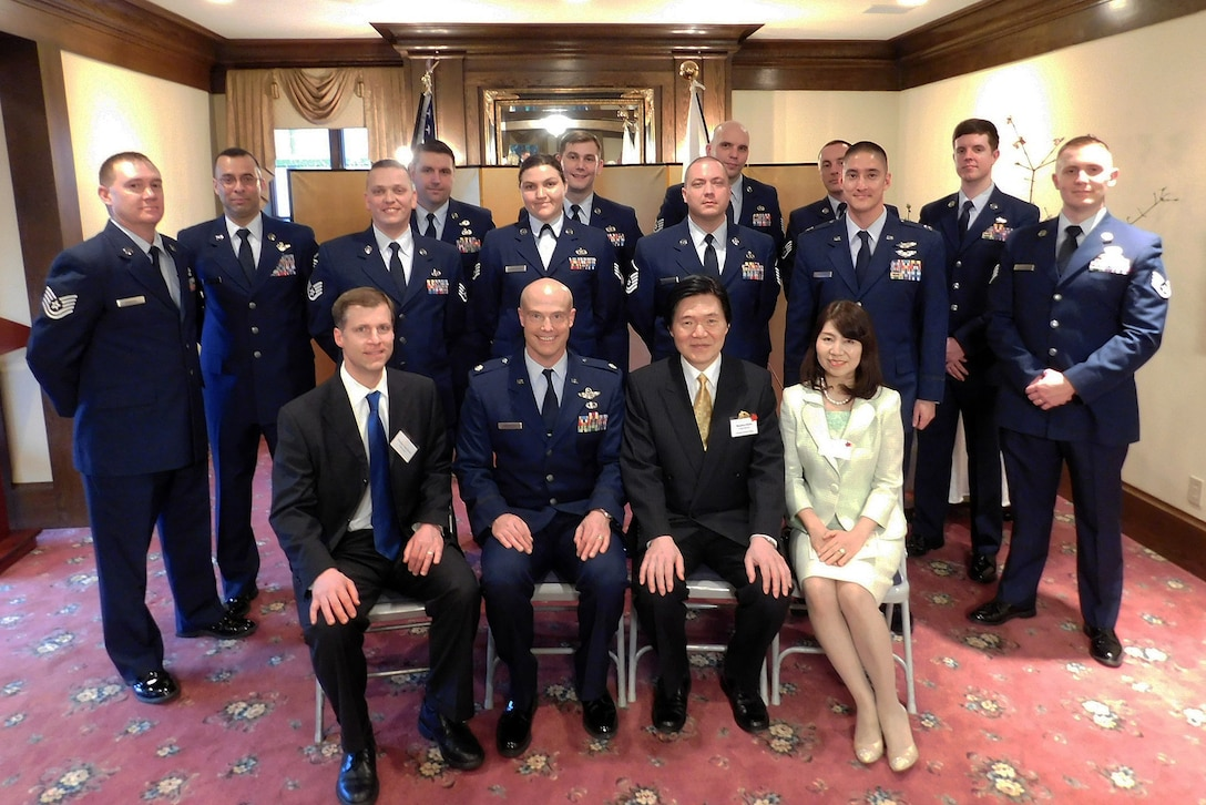 "Airmen from Joint Base Lewis-McChord, Wash., including members from the 446th & 62nd Airlift Wing's, and the Western Air Defense Sector, participate in a group photo with the Consulate General of Japan Masahiro Omura, and his wife during his Tomodachi Reception in Seattle Feb. 19, 2016. Nearly 20 Airmen attended the lunch, due to their experiences when they were stationed in Japan, or participated in an exercise or operation with the Japanese, which helped strengthen the bilateral relationship. Tomodachi is the Japanese translation for ""friendship."" (Courtesy photo/Consulate General of Japan, Seattle)"