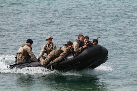 Marines with 3rd Reconnaissance Battalion demonstrate how to approach a beach in a Combat Rubber Raiding Craft during a raid to service members with the Japan Ground Self-Defense Force at Kin Blue, Okinawa, Japan, March 3, 2016. The JGSDF members watched the Marines perform raid missions and navigate using a nautical compass. The Marines are with 3rd Recon Bn., 3rd Marine Division, III Marine Expeditionary Force. (U.S. Marine photo by Cpl. Robert Williams Jr./Released)