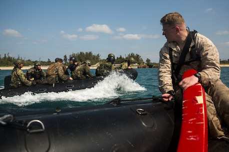 Cpl. Lionel Armstrong observes while members of the Japanese Ground Self-Defense Force navigate the seas in a Combat Rubber Raiding Craft at Kin Blue, Okinawa, Japan, March 3, 2016. The JGSDF members watched the Marines perform raid missions and navigate using a nautical compass. Armstrong, from Richland, Michigan, is a safety swimmer with 3rd Reconnaissance Battalion, 3rd Marine Division, III Marine Expeditionary Force. (U.S. Marine photo by Cpl. Robert Williams Jr./Released)