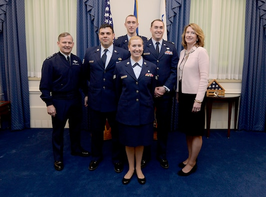 Lt. Gen. John Hesterman, the Air Force assistant vice chief of staff, and Under Secretary of the Air Force Lisa S. Disbrow congratulate Team 3-D Printing in the Pentagon, Feb. 29, 2016. (U.S. Air Force photo/Scott M. Ash)