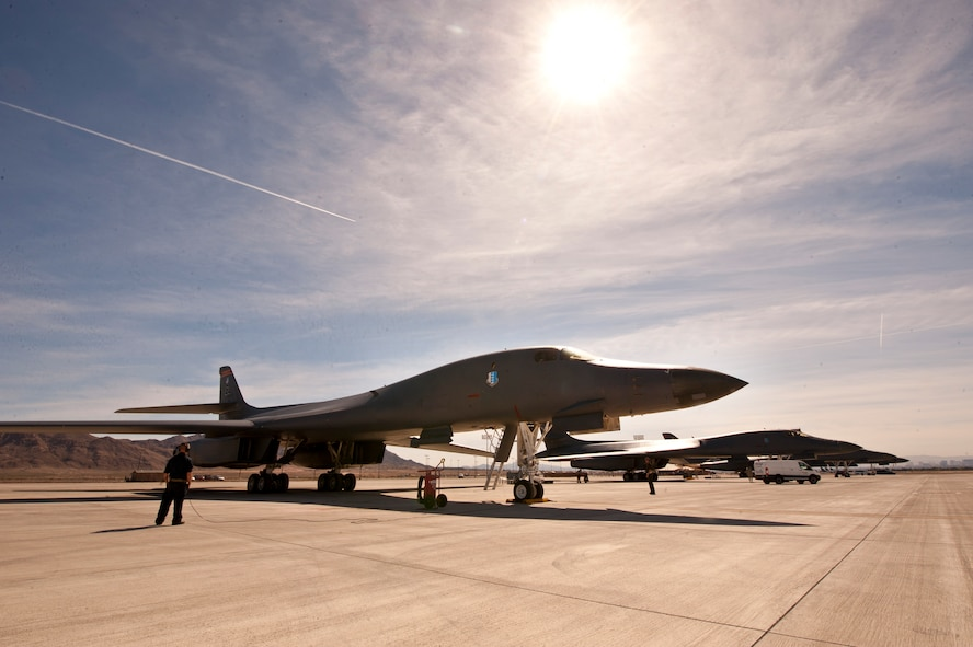 B-1 bombers assigned to the 34th Bomb Squadron receive final preparations before takeoff for a Red Flag 16-2 training sortie at Nellis Air Force Base, Nev., March 3, 2016. Red Flag exercises typically occur four times annually, with a focus on refining air, ground, space, and cyber integration in a contested-degraded environment. (U.S. Air Force photo by Senior Airman Joshua Kleinholz)