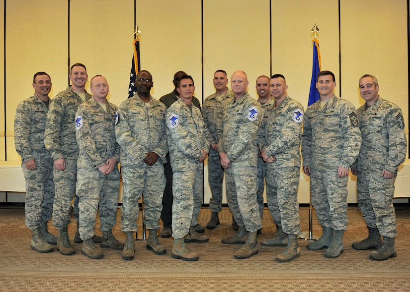Joint Base Charleston's newest Senior Master Sergeant selects pose for a group photo with leadership from both the 628th Air Base Wing and the 437th Airlift Wing during the promotion selection party held at the Charleston Club, March 4, 2016. The base had 11 selectees total, representing the 12.32 percent of all promotees. (U.S. Air Force photo/Tech. Sgt. Renae Pittman)