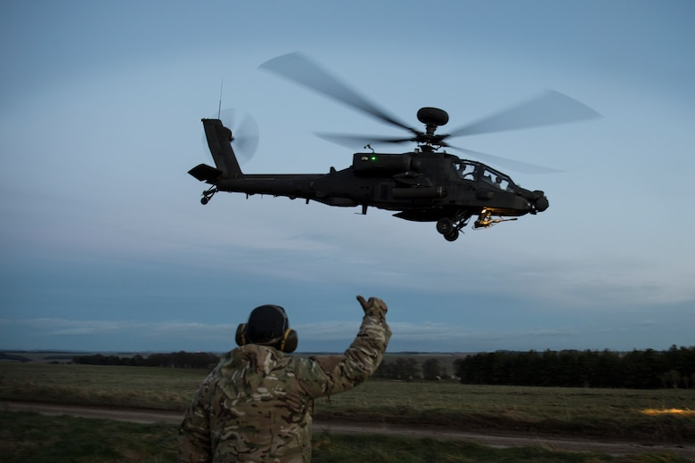 A British Army AH-64 Apache from 663 Squadron, 3 Regiment Army Air Corps, takes off during exercise Voijek Valour from Salisbury Plain, England, March 2, 2016. The exercise included six helicopters, 250 British soldiers and more than a dozen jets conducting scenarios across Salisbury Plain. (U.S. Air Force photo/Airman 1st Class Erin R. Babis)