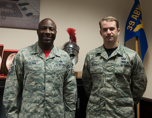 Chief Master Sgt. Vegas Clark, 39th Air Base Wing command chief, stands with Senior Airman Chad Barber, 39th Civil Engineer Squadron explosive ordnance technician, in the 39th ABW conference room before beginning Barber's chief shadow day March 4, 2016. Airmen are chosen for the command chief's shadow program based on their commander's recommendation for their dedication to the mission. (U.S. Air Force photo by Tech. Sgt. Joshua Jasper/Released)