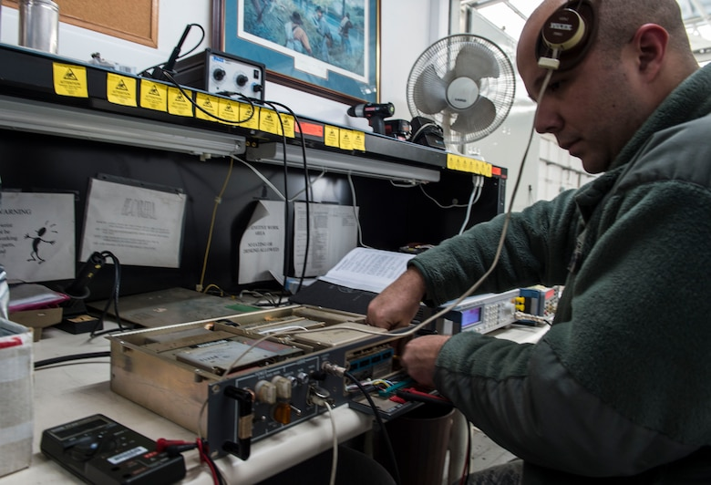 Staff Sgt. Derrick Shelton, 424th Air Base Squadron airfield systems technician, repairs a radio at Chièvres Air Base, Belgium, Feb. 25, 2016. Airmen from the 424th ABS provide airfield operations support for the Supreme Allied Commander Europe and Supreme Headquarters Allied Powers Europe (SHAPE), NATO transient aircraft and distinguished visitors. (U.S. Air Force photo/Staff Sgt. Sara Keller)
