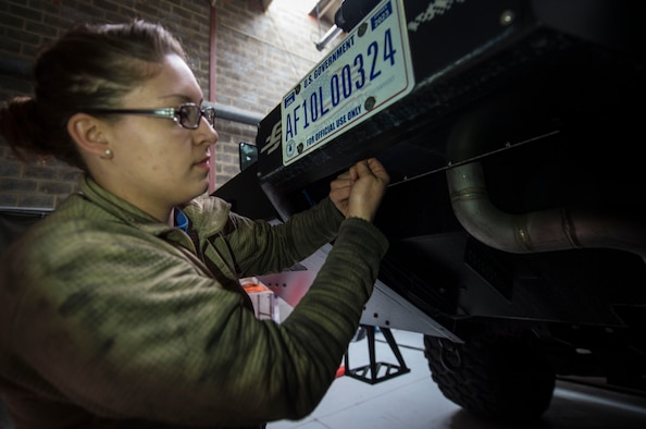 Senior Airman Nicole Franklin, 424th Air Base Squadron special vehicle mechanic, inspects the no-foam system on a Striker 1500 firetruck at Chièvres Air Base, Belgium, Feb. 26, 2016. Airmen with the 424th ABS provide airfield operations support for the Supreme Allied Commander Europe and Supreme Headquarters Allied Powers Europe (SHAPE), NATO transient aircraft and distinguished visitors. (U.S. Air Force photo/Staff Sgt. Sara Keller)
