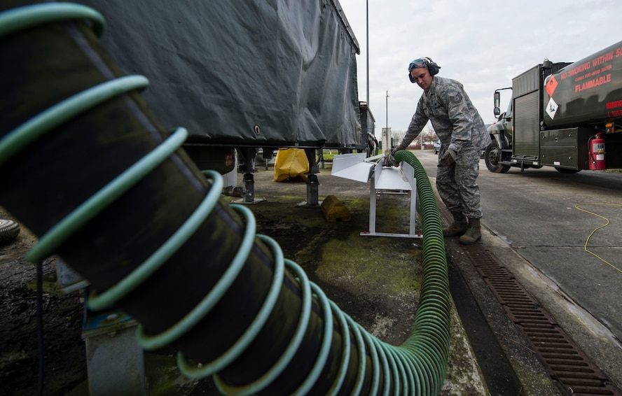 Tech. Sgt. Marcus Romero, 424th Air Base Squadron fuels management technician, stows a hose after refilling a fuel truck at Chièvres Air Base, Belgium, Feb. 25, 2016. Romero is one of 70 Airmen assigned to the 424th ABS. (U.S. Air Force photo/Staff Sgt. Sara Keller)