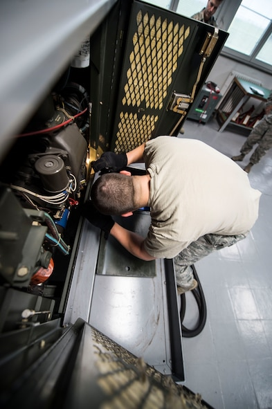 Staff Sgt. Andrew Bublik, 424th Air Base Squadron aerospace ground equipment craftsman, performs a phase inspection on a diesel generator used to power aircraft at Chièvres Air Base, Belgium, Feb. 26, 2016. AGE is one of the 18 career fields employed in the squadron that functions as the senior airfield authority for the airfield on behalf of the U.S. (U.S. Air Force photo/Staff Sgt. Sara Keller)