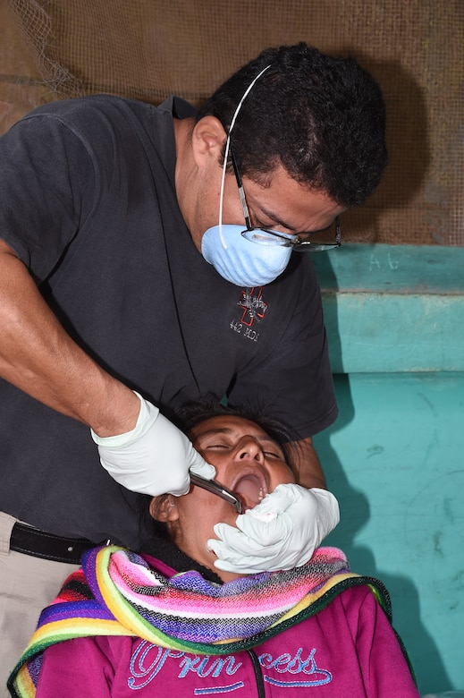 LA PAZ, Honduras – Dr. Wilmer Amador, Joint Task Force-Bravo Medical Liaison, extracts a tooth from a Honduran patient during a Medical Readiness Training Exercise in La Paz Department, Honduras, March 2, 2016. During the two-day exercise patients received basic dental treatment with a total of 164 extractions performed as part of a joint effort to provide basic health care between Honduras and the U.S.  (U.S. Army photo by Martin Chahin/Released)