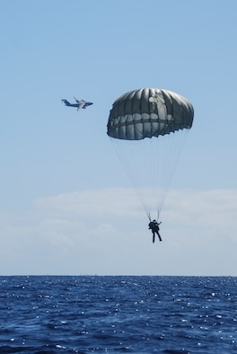 HONOLULU, Hawaii -- Senior Airman Jason Hughes, a pararescueman with the 212th Rescue Squadron, jumps from a C-17 Globemaster III here Feb. 23, 2016. Almost 50 Air Guardsman of the 249th Airlift Squadron, 212th Rescue Squadron and 176th Wing support units participated in a search and rescue exercise in the Pacific Air Forces' warmer waters of Honolulu. (U.S. Air National Guard photo by Staff Sgt. Christopher Blue)