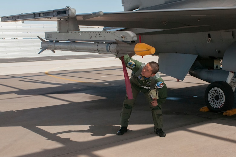 1st Lt. Fumita Sakyu does a final inspection of his F-16 Fighting Falcon prior to taking off for a training sortie at the Arizona Air National Guard's 162nd Wing located at Tucson International Airport. Japan turned to the premier training program here after a massive earthquake triggered a tsunami that devastated its northeast coast. Although there are no F-16s in the Japanese inventory, their multi-role F-2 is based on the F-16 design, with modifications to meet the needs of the JASDF.  (U.S. Air National Guard photo by 2nd Lt. Lacey Roberts)