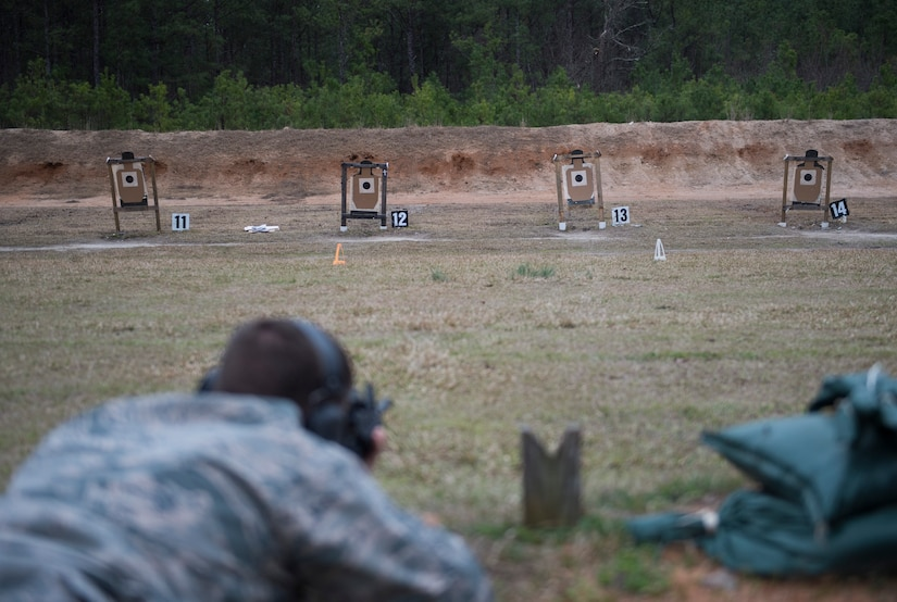 A combat camera Airman fires at a paper target March 3, 2016, during exercise Scorpion Lens 2016, at McCrady Training Center, Fort Jackson, South Carolina. The exercise is an annual training requirement incorporating combat camera job qualification standards and advanced weapons and tactical training with Army instructors. (U.S. Air Force photo/Staff Sgt. Jared Trimarchi)