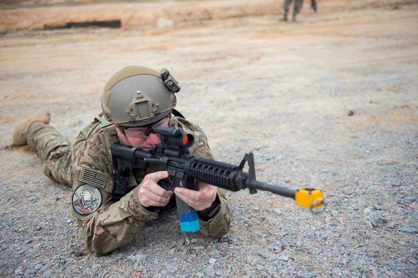 Staff Sgt. Jonathan Snyder, a combat photojournalist from the 3rd Combat Camera Squadron,  watches his sector March 3, 2016, during exercise Scorpion Lens 2016, at McCrady Training Center, Fort Jackson, South Carolina. The exercise is an annual training requirement incorporating combat camera job qualification standards and advanced weapons and tactical training with Army instructors. (U.S. Air Force photo/Staff Sgt. Jared Trimarchi)