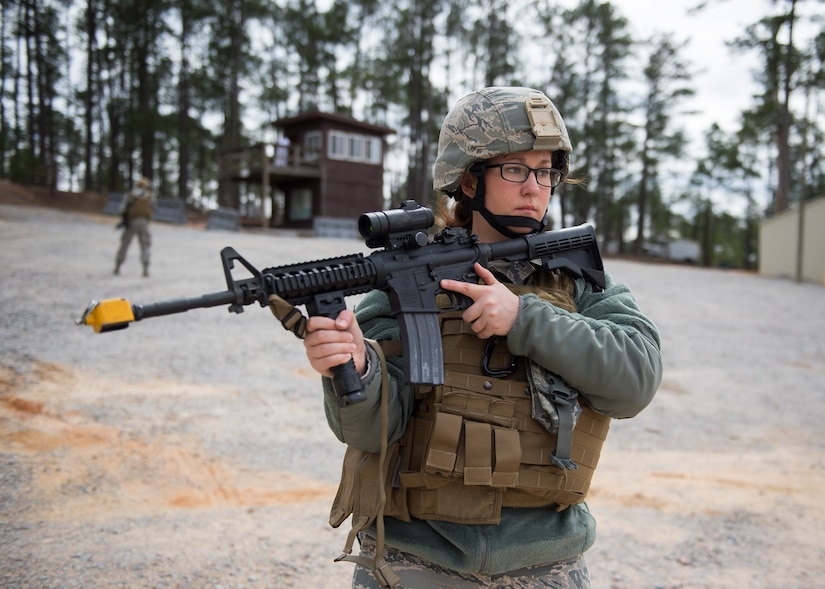 Airman Brittany Gould, a combat broadcast journalist from the 3rd Combat Camera Squadron,  listens to an instructor March 3, 2016, during exercise Scorpion Lens 2016, at McCrady Training Center, Fort Jackson, South Carolina. The exercise is an annual training requirement incorporating combat camera job qualification standards and advanced weapons and tactical training with Army instructors. (U.S. Air Force photo/Staff Sgt. Jared Trimarchi)