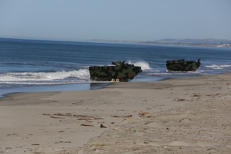 Amphibious Assault Vehicles assault the beach after launching from the USS Essex (LHD 2) during a Marine Corps Combat Readiness Evaluation Feb. 25, 2016. The MCCRE evaluates the readiness of the Marines of Company A, 3rd Assault Amphibian Battalion prior to their deployment to Okinawa, Japan. (U.S. Marine Corps photo by Lance Cpl. Timothy Valero/ Released)